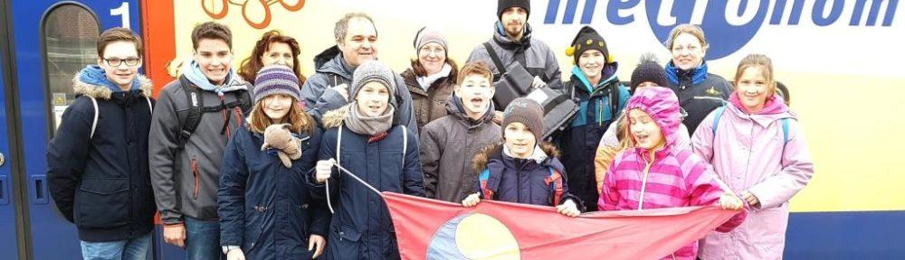 Gruppenfoto vor Metronom-Zug